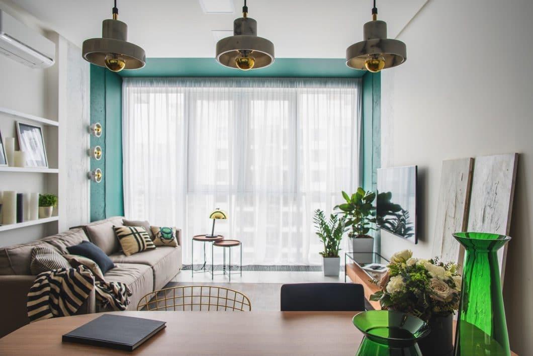 Die Herausforderung, eine Wohnküche einzurichten, ist groß. Insbesondere, wenn die Einbauküche ein Inneneinrichtungsstatement ist. (Design: Oksana Dolgopiatova)
