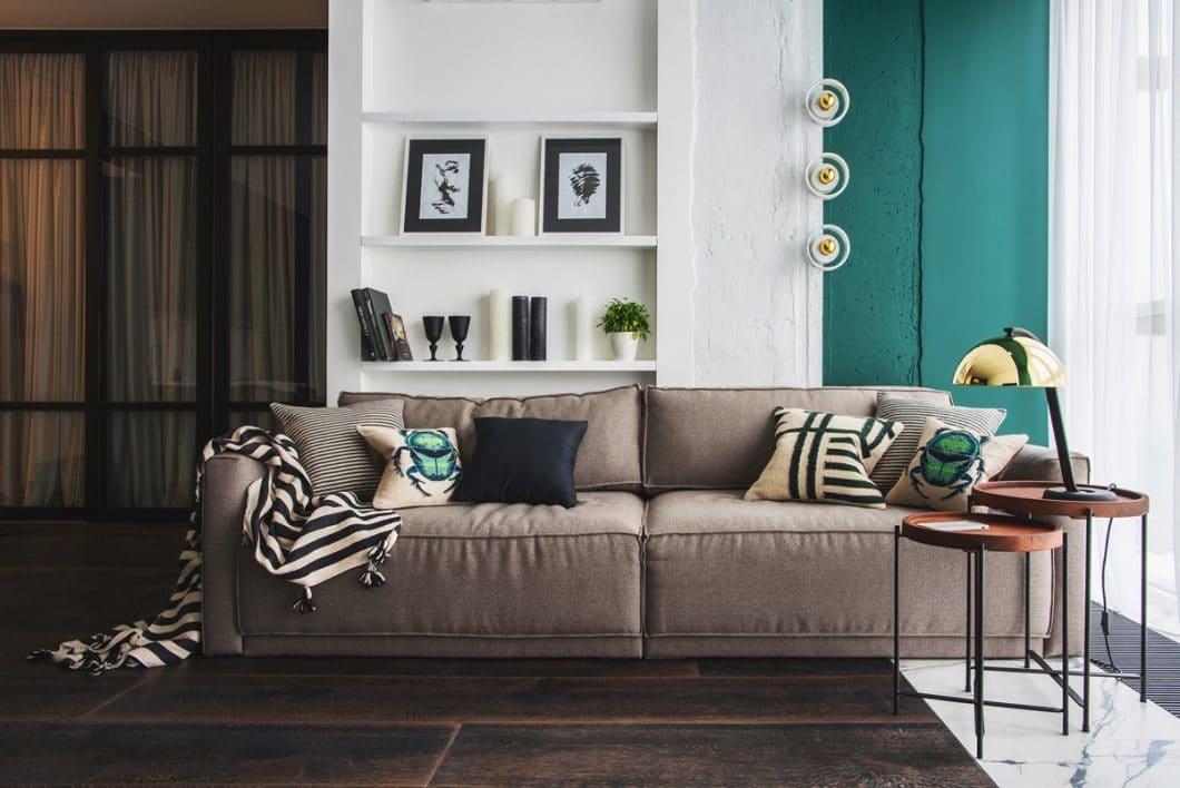 Grün ist unter anderem die Farbe der Ruhe. Kombiniert mit weichen Holz- und Erdtönen wird diese Eigenschaft unterstrichen. (Design: Oksana Dolgopiatova)