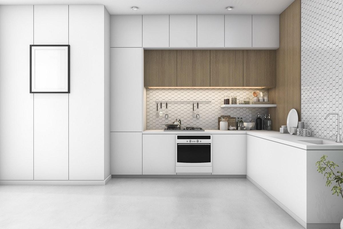 Die individuelle Holzverkleidung der ersten Oberschrank-Ebene lässt den sonst minimalistisch gestalteten Raum wärmer wirken. Damit - sowie mit der unterschiedlichen Schranktiefe - setzt sich diese L-Küche von herkömmlichen Formen ab. (Foto: Stock Adobe/dit26978)