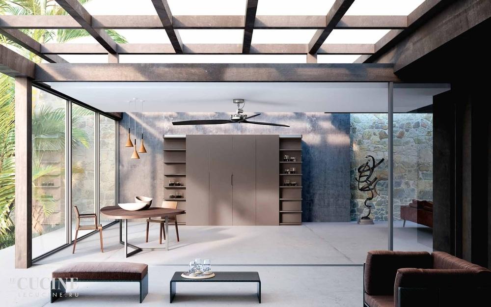 Klar und geradlinig wurde dieses moderne Loft eingerichtet. Küche und Wohnraum verschmelzen miteinander - vor allem deshalb, weil die Küche versteckt bleibt. (Foto: Lineaquattro / Metamorphosis)